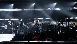 Arcade Fire performs at the 53rd annual Grammy Awards on Sunday, Feb. 13, 2011, in Los Angeles. (AP Photo/Matt Sayles)