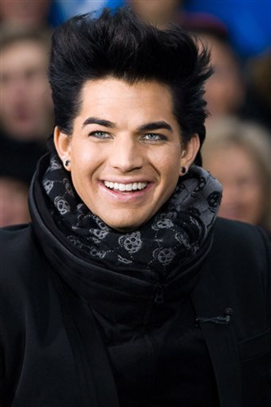 "FILE - In this Nov. 25, 2009  file photo, singer Adam Lambert discusses his controversial ""American Music Awards"" appearance during an interview on CBS News' ""The Early Show"" in New York, (AP Photo/Charles Sykes, File)"