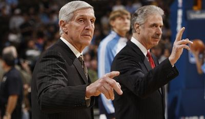 FILE - This jan. 17, 2010, file photo shows Utah Jazz head coach Jerry Sloan, front, and assistant coach Phil Johnson waving before facing the Denver Nuggets in the first quarter of an NBA basketball game,  in Denver. A person with knowledge of the situation says Sloan is stepping down as head coach of the Jazz. The person also told The Associated Press on Thursday, Feb. 10, 2011,  that longtime assistant Phil Johnson also will resign. (AP Photo/David Zalubowski)