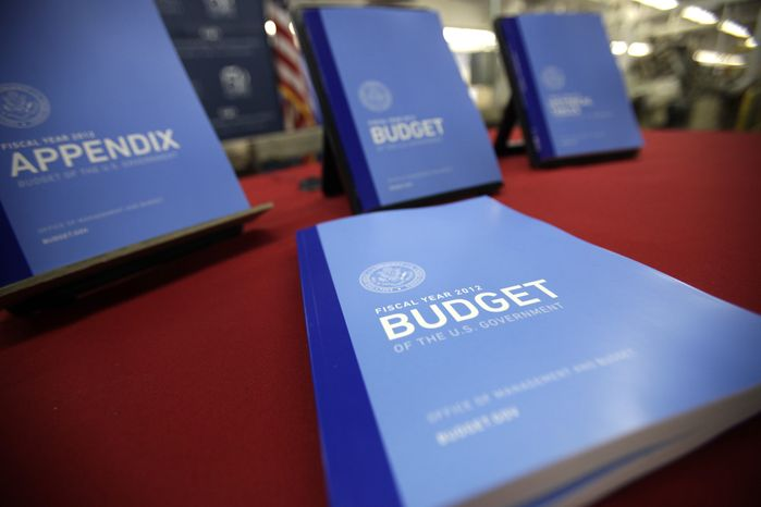 The 2012 federal budget is on display at the U.S. Government Printing Office at Washington on Thursday, Feb. 10, 2011. (AP Photo/Jacquelyn Martin)