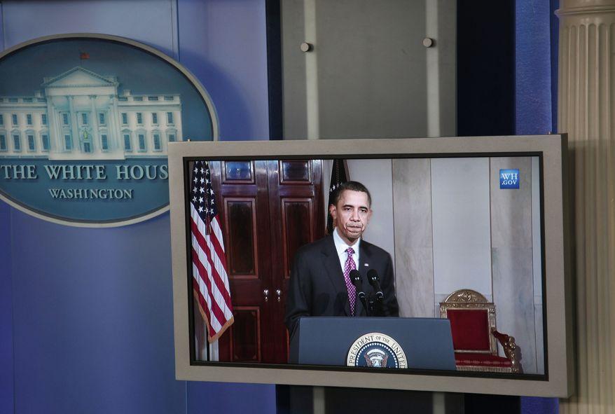 President Barack Obama's image is seen broadcast inside the White House Briefing Room in Washington, Friday, Feb., 11, 2011. Obama was making a statement on the resignation of Egypt's President Hosni Mubarak. (AP Photo/Pablo Martinez Monsivais)