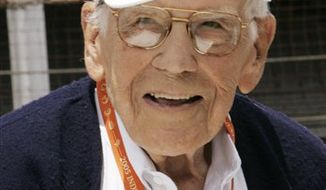 FILE - In this May 28, 2005 file photo, Tom Carnegie, track announcer at the Indianapolis Motor Speedway until 2006, is recognized during the annual Indy 500 drivers' meeting at the track. The longtime voice of the track died Friday, Feb. 11, 2011 at his home in Indianapolis. He was 91. (AP Photo/Al Behrman, File)