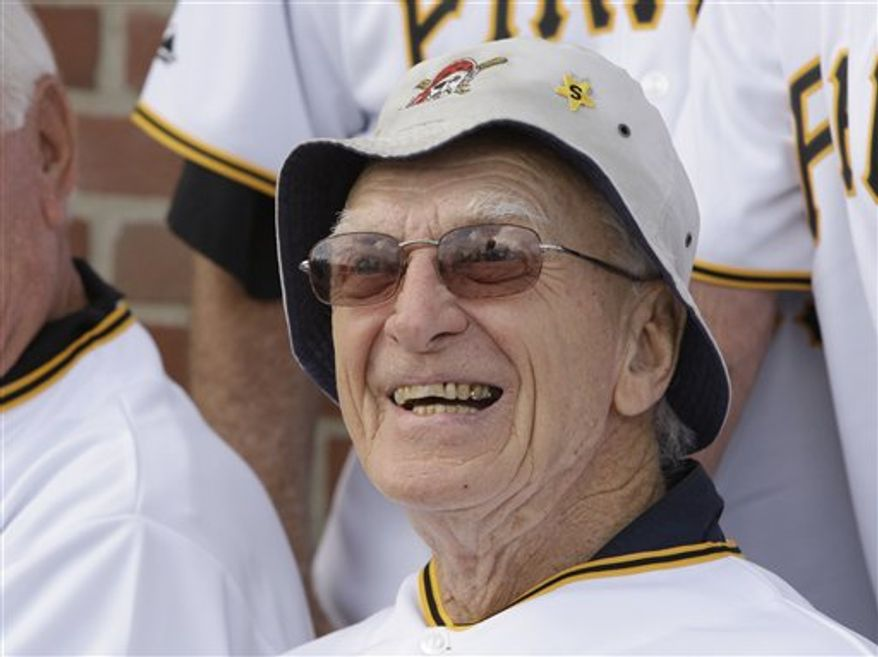 FILE - In this Aug. 22, 2009, file photo, Former Pittsburgh Pirates manager Chuck Tanner, right, and Phil Garner walk off the field arm-in-arm after a ceremony honoring their 1979 World Series Championship team before a baseball game against the Cincinnati Reds in Pittsburgh. Tanner, who managed the Pirates to one of the greatest comebacks in World Series history in 1979, died Friday, Feb. 11, 2011, at his home in New Castle, Pa., after a long illness, the team Pirates said. He was 81. (AP Photo/Keith Srakocic, File)