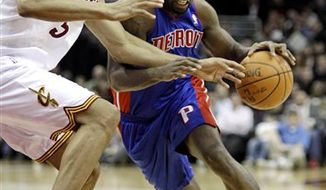 Cleveland Cavaliers head coach Byron Scott, right, talks with Baron Davis during the fourth quarter in an NBA basketball game against the Detroit Pistons Friday, March 25, 2011, in Cleveland. The Cavaliers won 97-91. (AP Photo/Tony Dejak)
