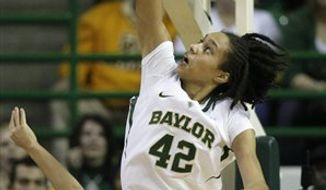 Baylor's Perry Jones (5) shoots over Texas' Matt Hill (21) in the second half of an NCAA college basketball game Saturday, March 5, 2011, in Waco, Texas. Texas won 60-54. (AP Photo/Tony Gutierrez)