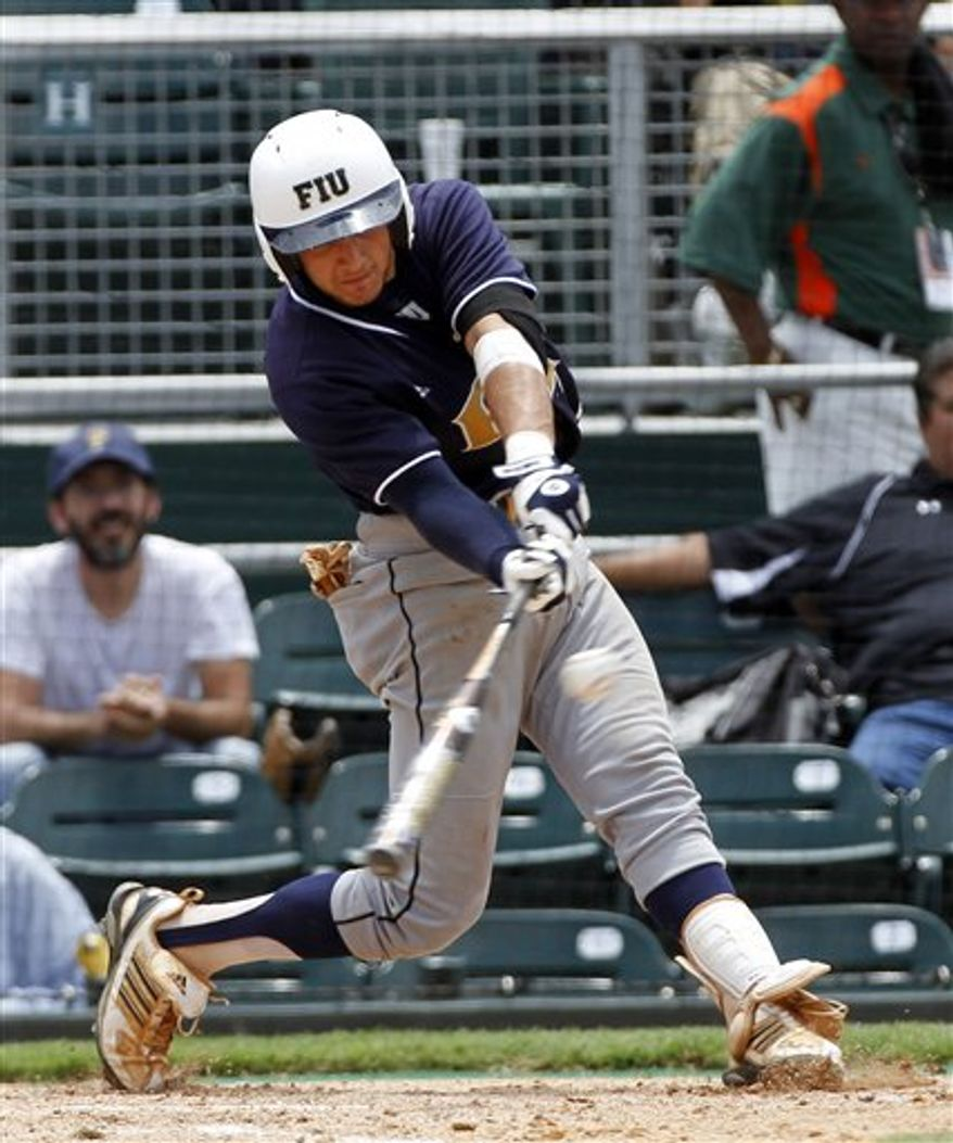 FILE - In this June 4, 2010, file photo, Florida International baseball player Garrett Wittels extends his hitting streak to 55 games with a sixth inning double during an NCAA college baseball game against Texas A&M in Coral Gables. It was not an easy offseason for the shortstop who got a hit in each of FIU's 56 games last season, putting him within two of matching Robin Ventura's Division I record. He struggled in summer ball and dealt with more attention than he found comfortable. (AP Photo/J Pat Carter, File)
