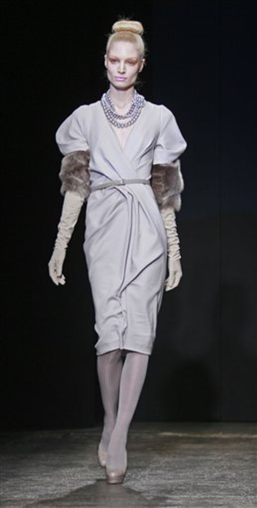 Fashion from the fall 2011 collection of Donna Karan is modeled on Monday, Feb. 14, 2011 in New York.  (AP Photo/Bebeto Matthews)