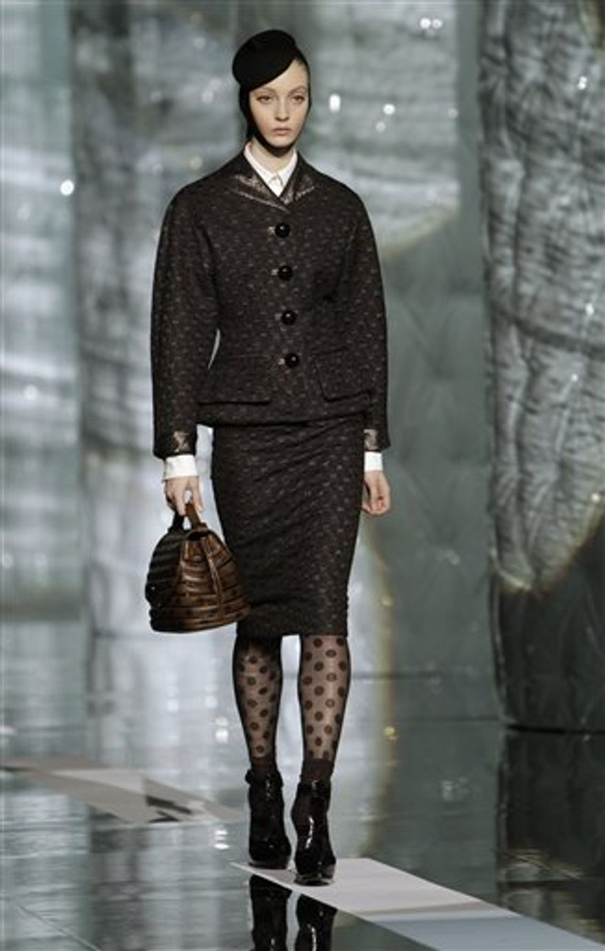 Models parade down the runway at the conclusion of the Marc Jacobs Fall 2011 show during Fashion Week in New York, Monday, Feb. 14, 2011. (AP Photo/Kathy Willens)