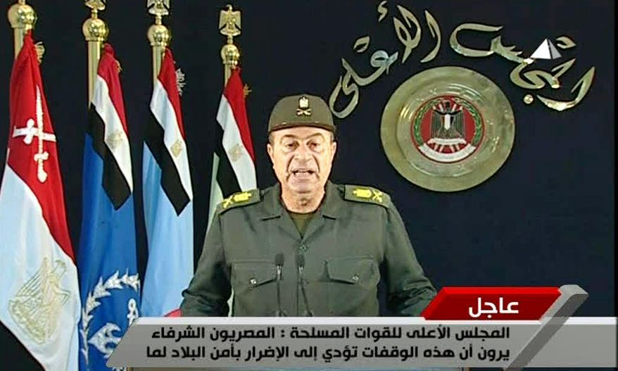 An unidentified Egyptian army major general on Monday addresses the nation on state television about ending labor unrest. (Associated Press)