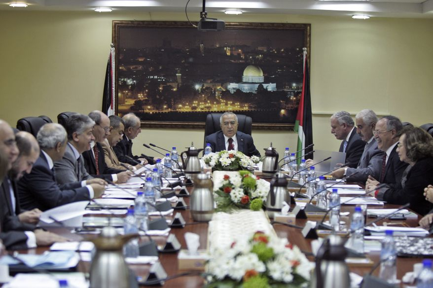 Palestinian Prime Minister Salam Fayyad speaks to his Cabinet members after a meeting in the West Bank city of Ramallah, Monday, Feb. 14 , 2011. The Palestinian prime minister dissolved his Cabinet in an emergency meeting Monday, in what appeared to be a new gesture by the Western-backed government to be inspired by unrest rocking the Arab world.(AP Photo/Majdi Mohammed)