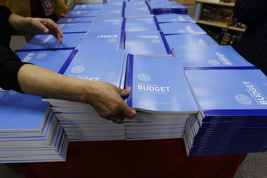 Copies of the U.S. government budget for fiscal 2012 are stacked up at the U.S. Government Printing Office in Washington on Monday, Feb. 14, 2011. (AP Photo/Alex Brandon)