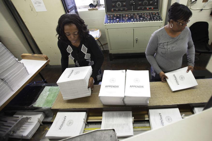 Willow Wimbush, left, and Nancy Harris, work on copies of the Appendix of the 2012 budget at the U.S. Government Printing Office at Washington on Feb. 10, 2011. President Obama will send his 2012 budget proposal to Congress on Monday, Feb. 14. (AP Photo/Jacquelyn Martin)