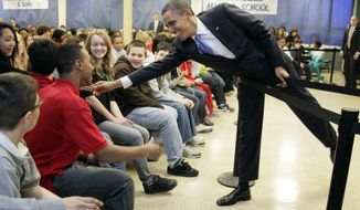 President Obama reaches to shake hands with eighth-graders as he speaks at Parkville Middle School and Center of Technology in Parkville, Md., on Monday, Feb., 14, 2011. (AP Photo/Carolyn Kaster)