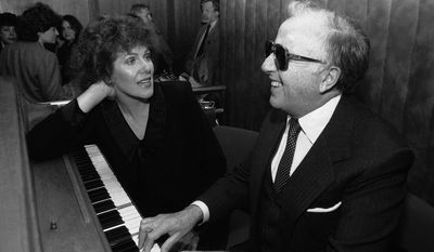 "** FILE ** Jazz pianist George Shearing, here with actress Lynn Redgrave, plays at an Arts and Entertainment Network party in New York in 1968. Mr. Shearing, who wrote the standard ""Lullaby of Birdland"" and had a string of hits both with and without his quintet, died on Monday, Feb. 14, 2011, in New York of congestive heart failure. He was 91. (AP Photo/Richard Drew, File)"