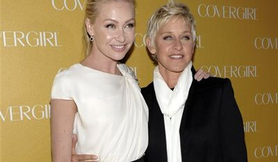 FILE - In this Jan. 5, 2011 file photo, television personality Ellen DeGeneres, right, and actress Portia de Rossi arrive at the COVERGIRL Cosmetics' 50th Anniversary Party in Los Angeles.  (AP Photo/Dan Steinberg, file)