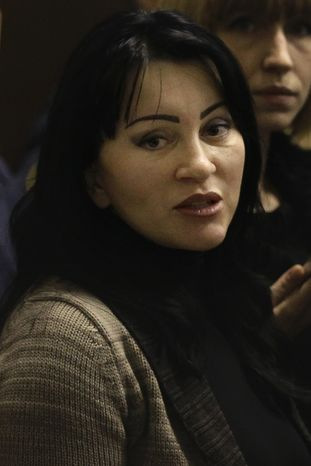 Natalya Vasilyeva, the assistant to the judge who sentenced oil tycoon Mikhail Khodorkovsky, said the verdict was imposed upon the judge when it became clear that top Russian officials did not think his own ruling would be tough enough. (AP Photo/Ivan Sekretarev)