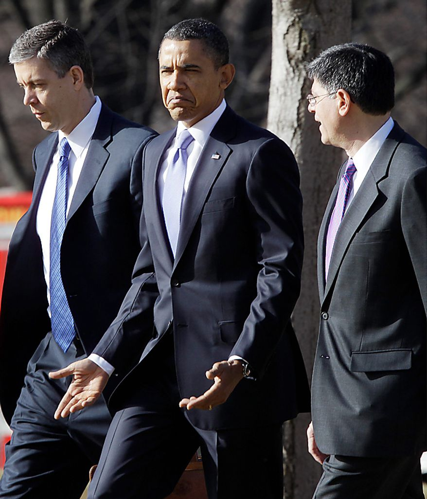 President Barack Obama walks with budget director Jack Lew and Education Secretary Arne Duncan on the South Lawn of the White House in Washington as they travel to Baltimore, Md., Monday, Feb. 14, 2011. (AP Photo/Charles Dharapak)