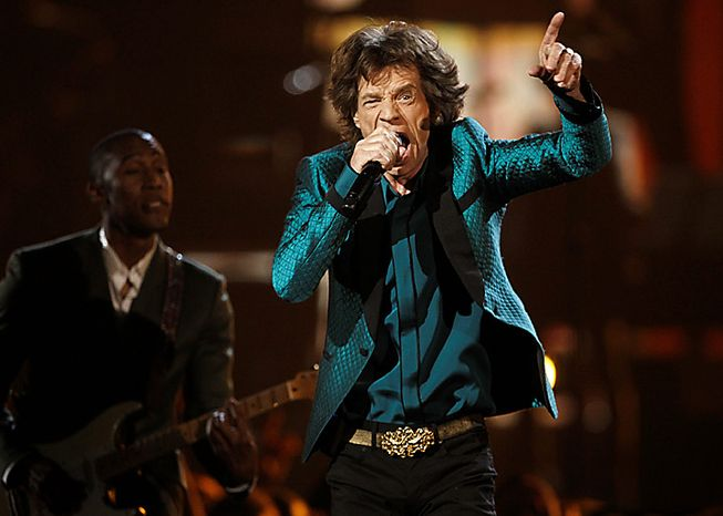 From left, Raphael Saadiq and Mick Jagger perform at the 53rd annual Grammy Awards on Sunday, Feb. 13, 2011, in Los Angeles. (AP Photo/Matt Sayles)