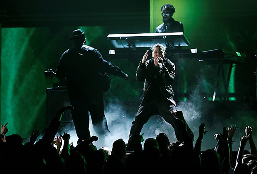 Eminem performs at the 53rd annual Grammy Awards on Sunday, Feb. 13, 2011, in Los Angeles. (AP Photo/Matt Sayles)