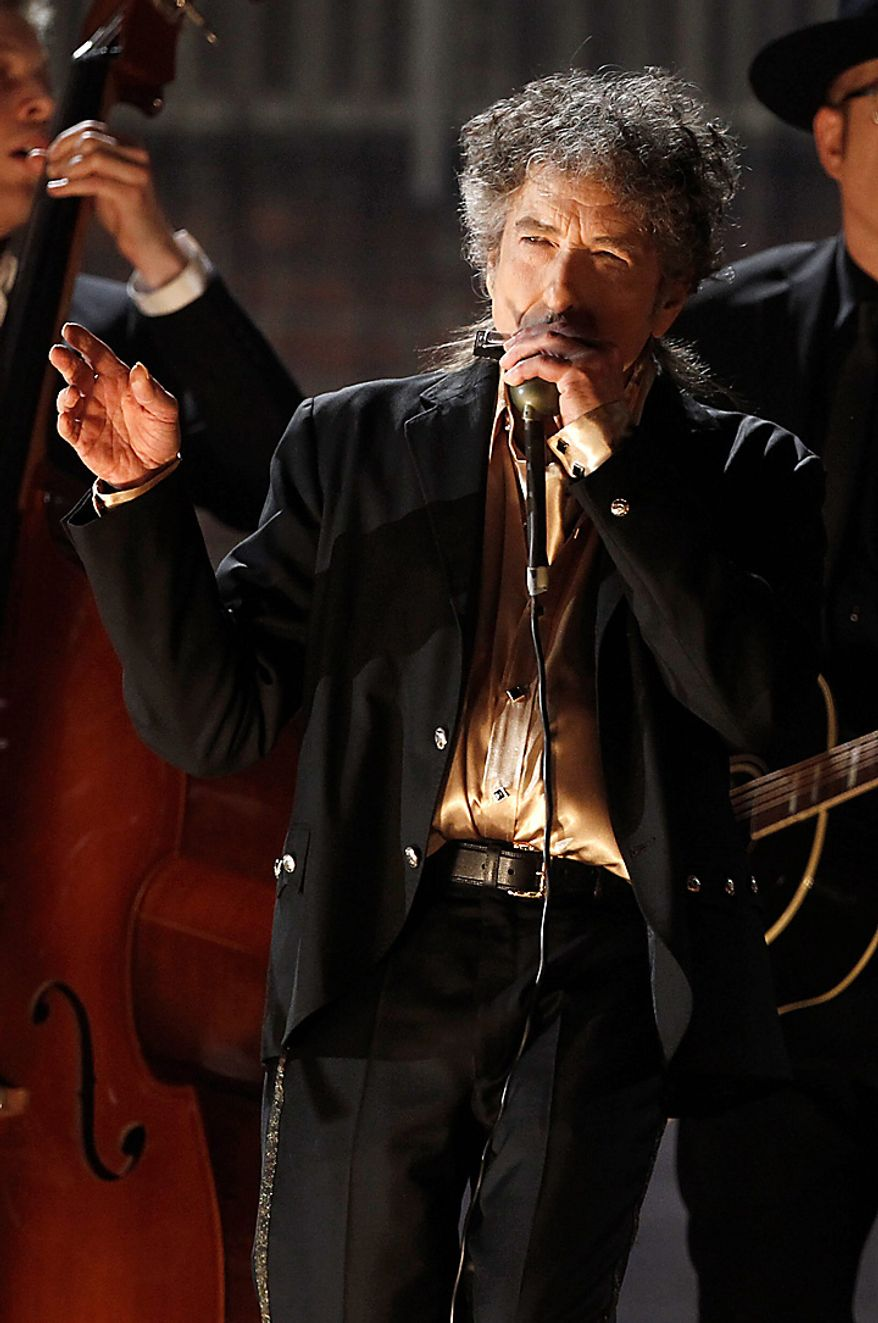 Bob Dylan performs at the 53rd annual Grammy Awards on Sunday, Feb. 13, 2011, in Los Angeles. (AP Photo/Matt Sayles)