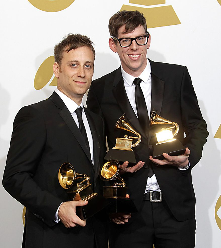 Dan Auerbach, left, and Patrick Carney pose backstage with the awards for best alternative music album and Best Rock Performance by a Duo or Group with Vocals at the 53rd annual Grammy Awards on Sunday, Feb. 13, 2011, in Los Angeles. (AP Photo/Jae C. Hong)