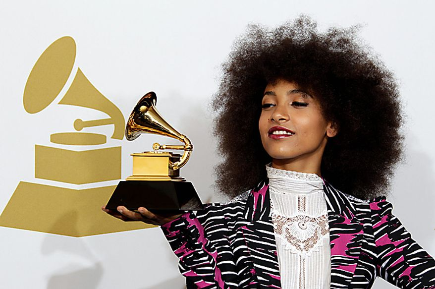 Esperanza Spalding poses backstage with the award for best new artist at the 53rd annual Grammy Awards on Sunday, Feb. 13, 2011, in Los Angeles. (AP Photo/Jae C. Hong)