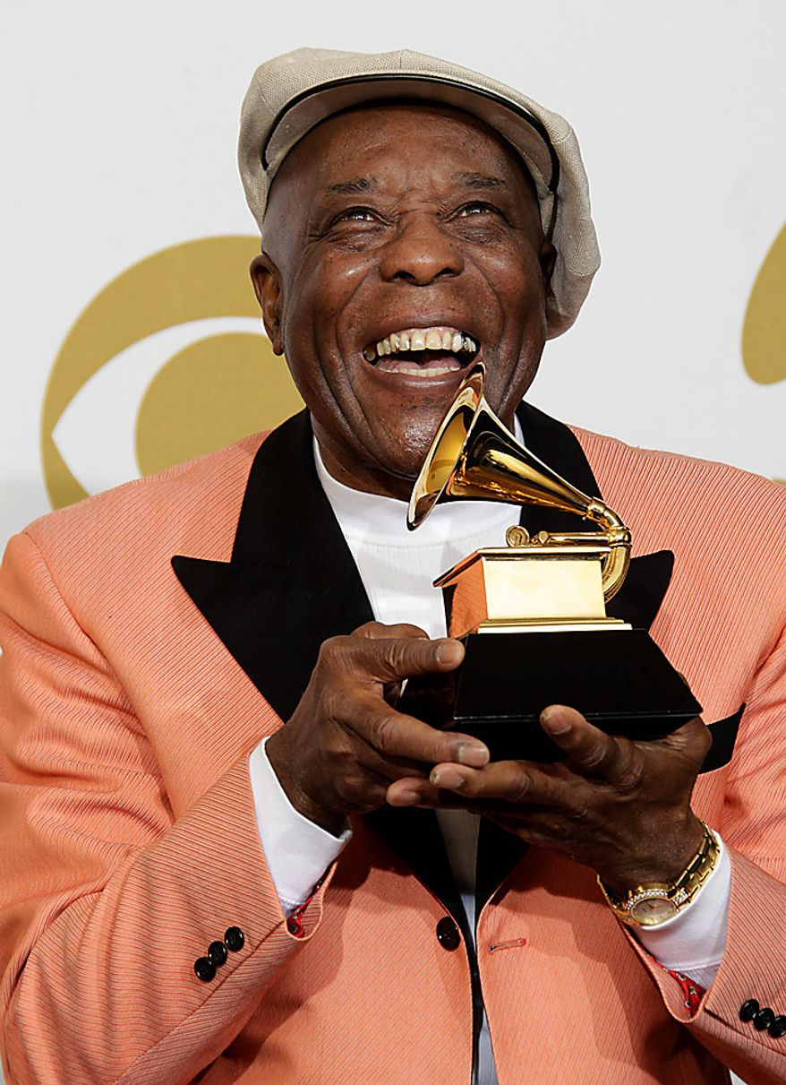 Buddy Guy poses backstage with the award for best contemporary blues album at the 53rd annual Grammy Awards on Sunday, Feb. 13, 2011, in Los Angeles. (AP Photo/Jae C. Hong)