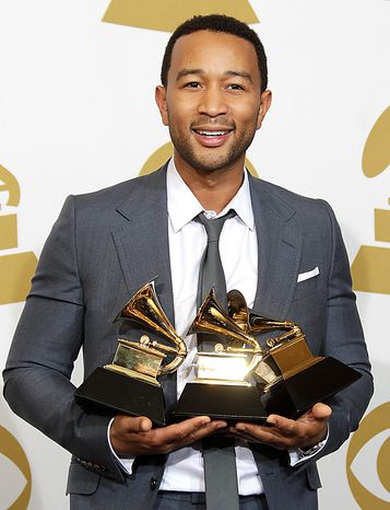 John Legend is seen backstage with the awards for best R&B album, best R&B song, and best traditional R&B vocal performance at the 53rd annual Grammy Awards on Sunday, Feb. 13, 2011, in Los Angeles. (AP Photo/Jae C. Hong)