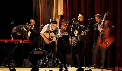 Mumford and Sons perform at the 53rd annual Grammy Awards on Sunday, Feb. 13, 2011, in Los Angeles. (AP Photo/Matt Sayles)