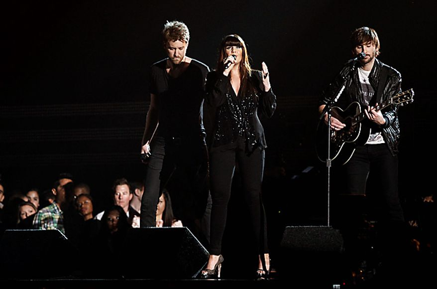 Lady Antebellum, from left, Charles Kelley, Hilary Scott, and Dave Haywood, perform at the 53rd annual Grammy Awards on Sunday, Feb. 13, 2011, in Los Angeles. (AP Photo/Matt Sayles)