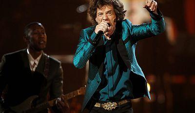 Raphael Saadiq, left, and Mick Jagger perform at the 53rd annual Grammy Awards on Sunday, Feb. 13, 2011, in Los Angeles. (AP Photo/Matt Sayles)