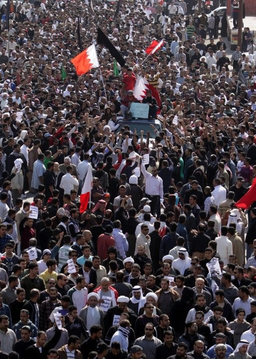 Streets in Jidhafs, Bahrain, are jammed Tuesday in a funeral procession for Ali Abdulhadi Mushaima, 21, killed in Monday's protests. Anger intensified when one of the mourners was shot fatally. (Associated Press)