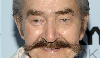 "FILE - In this Aug. 18, 2009 file photo, artist and illustrator Leroy Neiman attends the premiere of ""My One and Only "" at The Paris Theatre in New York. (AP Photo/Peter Kramer, file)"