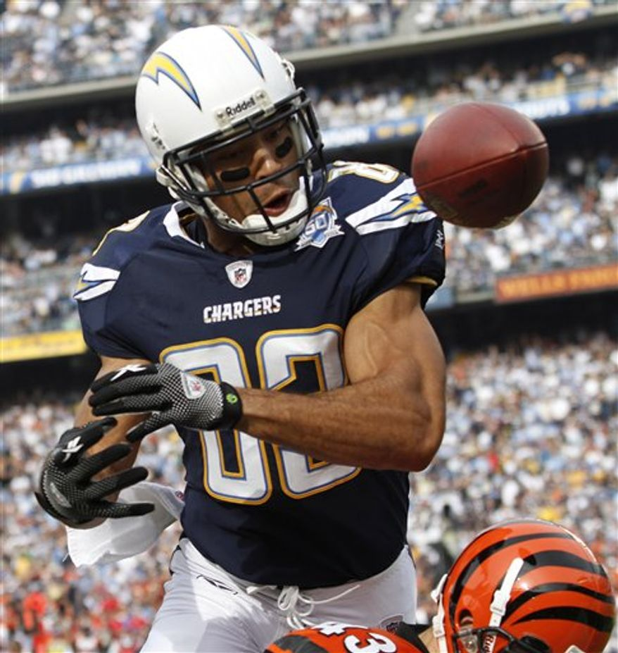 FILE - In this Dec. 20, 2009, file photo, San Diego Chargers wide receiver Vincent Jackson tries to make a catch during an NFL football game against the Cincinnati Bengals in San Diego. The Chargers placed the non-exclusive franchise tag Tuesday, Feb. 15, 2011, on Jackson, who missed the first 10 games last season in a nasty contract dispute. (AP Photo/Denis Poroy, File)