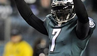 "FILE - In this Nov. 7, 2010, file photo, Philadelphia Eagles quarterback Michael Vick reacts after a touchdown in the first half of an NFL football game against the Indianapolis Colts in Philadelphia.  The Eagles have placed the franchise tag on Vick. The Eagles also placed the transition tag on Pro Bowl kicker David Akers. Coach Andy Reid says the moves Tuesday, Feb. 15, 2011,  ""ensure that they'll be back in Philadelphia next season.""  (AP Photo/Miles Kennedy, File)"