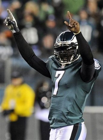 """FILE - In this Nov. 7, 2010, file photo, Philadelphia Eagles quarterback Michael Vick reacts after a touchdown in the first half of an NFL football game against the Indianapolis Colts in Philadelphia.  The Eagles have placed the franchise tag on Vick. The Eagles also placed the transition tag on Pro Bowl kicker David Akers. Coach Andy Reid says the moves Tuesday, Feb. 15, 2011,  """"ensure that they'll be back in Philadelphia next season.""""  (AP Photo/Miles Kennedy, File)"""