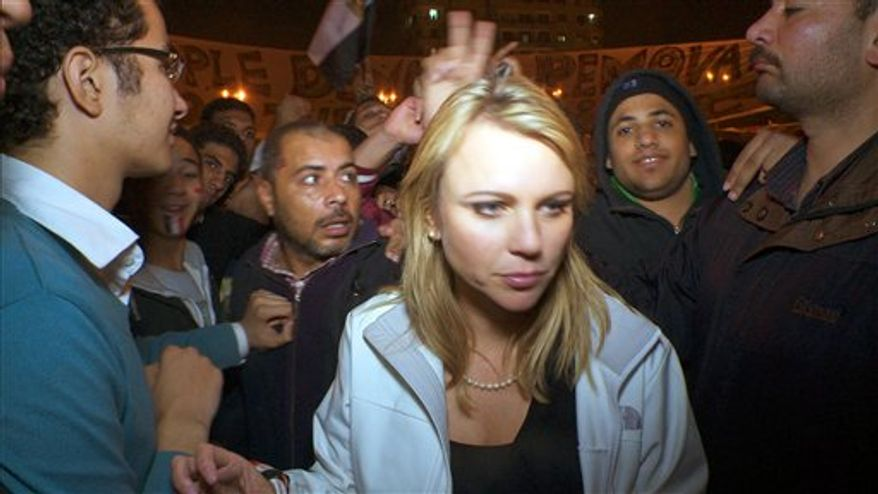"In this Feb. 11, 2011 photo released by CBS, ""60 Minutes"" correspondent Lara Logan is shown covering the reaction in in Cairo's Tahrir Square the day Egyptian President Hosni Mubarak stepped down.  CBS News says Logan was attacked Friday, and suffered a brutal beating and sexual assault before being saved by a group of women and an estimated 20 Egyptian soldiers. She is recovering in a U.S. hospital. Logan, CBS News' chief foreign affairs correspondent, is one of at least 140 correspondents who have been injured or killed since Jan. 30 while covering the unrest in Egypt, according to the Committee to Protect Journalists.  (AP Photo/CBS News)"