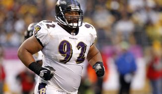 In this Oct. 3, 2010, photo, Baltimore Ravens defensive tackle Haloti Ngata (92) heads to the sidelines during an NFL football game against the Pittsburgh Steelers in Pittsburgh. (AP Photo/Keith Srakocic) **FILE**