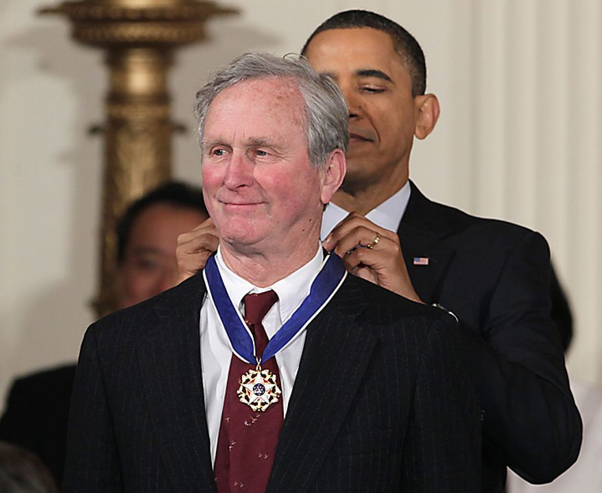 President Barack Obama presents a 2010 Presidential Medal of Freedom to John H. Adams, co-founder of the Natural Resources Defense Council, Tuesday, Feb. 15, 2011, during a ceremony in the East Room of the White House in Washington. (AP Photo/Carolyn Kaster)