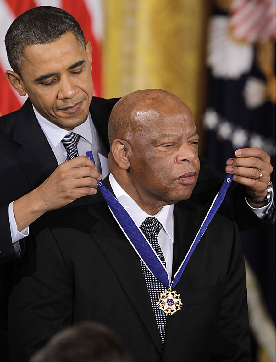 ** FILE ** President Barack Obama presents Rep. John Lewis, D-Ga., the 2010 Medal of Freedom during a ceremony in the East Room of the White House in Washington, Tuesday, Feb. 15, 2011. (AP Photo/Charles Dharapak)