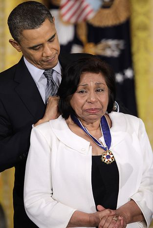 President Barack Obama awards civil rights activist Sylvia Mendez the 2010 Medal of Freedom during a ceremony in the East Room of the White House in Washington, Tuesday, Feb. 15, 2011. (AP Photo/Charles Dharapak)