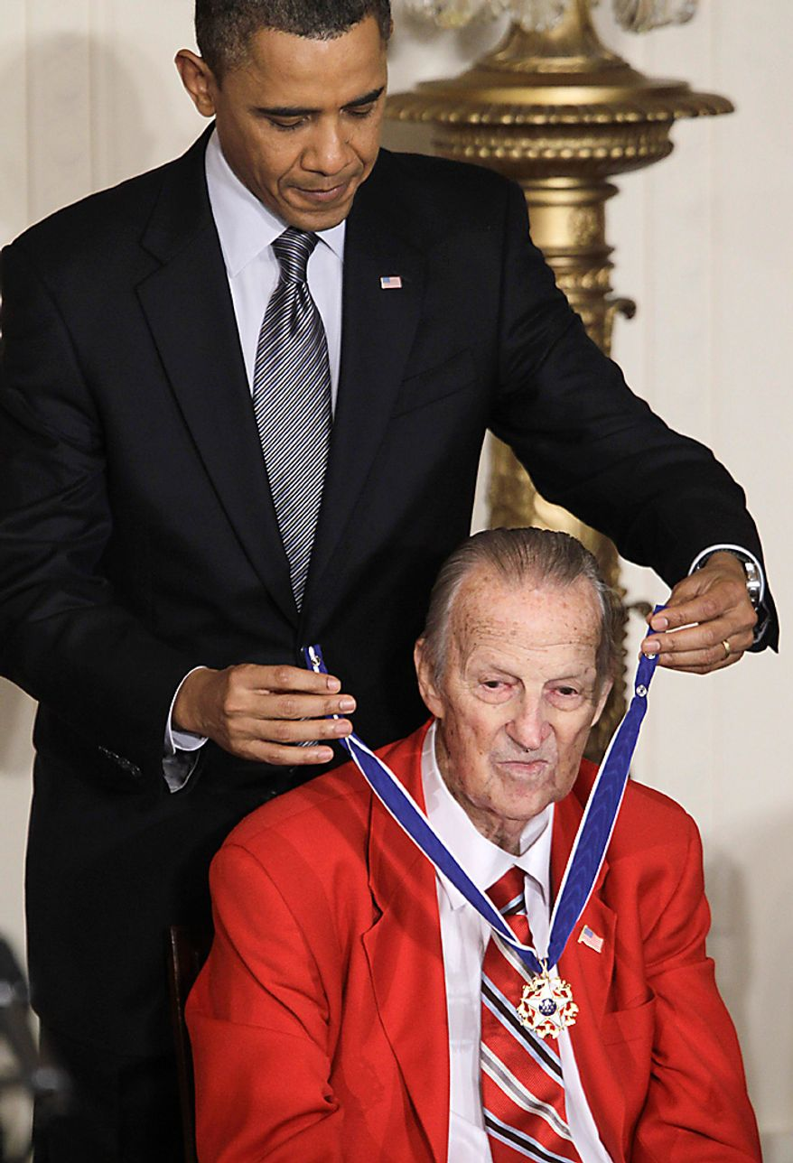 """President Barack Obama awards baseball hall of fame member, former St. Louis Cardinals great Stan """"The Man"""" Musial the 2010 Medal of Freedom during a ceremony in the East Room of the White House in Washington, Tuesday, Feb. 15, 2011. (AP Photo/Charles Dharapak)"""