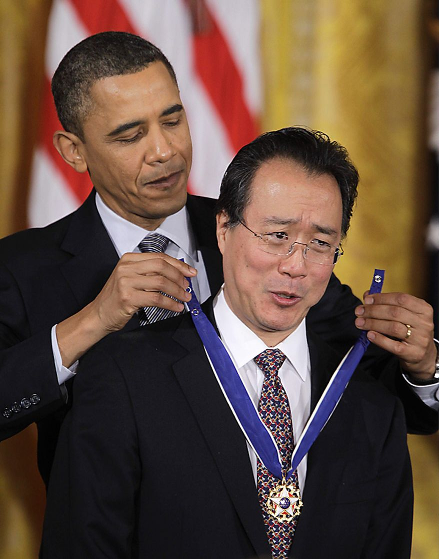 President Barack Obama awards cellist Yo-Yo Ma the 2010 Medal of Freedom during a ceremony in the East Room of the White House in Washington, Tuesday, Feb. 15, 2011. (AP Photo/Charles Dharapak)
