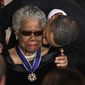 President Barack Obama kisses author and poet Maya Angelou after awarding her the 2010 Medal of Freedom during a ceremony in the East Room of the White House in Washington Tuesday, Feb. 15, 2011. (AP Photo/Charles Dharapak)