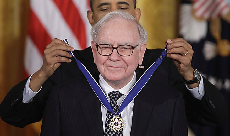 President Barack Obama awards the 2010 Medal of Freedom to Warren Buffett during a ceremony in the East Room of the White House in Washington Tuesday, Feb. 15, 2011. (AP Photo/Charles Dharapak)