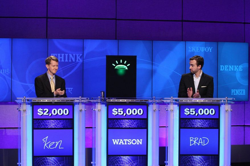 """Contestants Ken Jennings (left) and Brad Rutter and a computer named Watson compete on the game show """"Jeopardy!"""". (Associated Press)"""