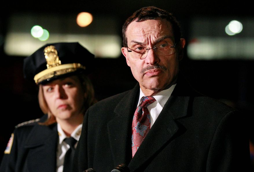 ** FILE ** D.C. Mayor Vincent C. Gray and Metropolitan Police Chief Cathy L. Lanier (Associated Press)