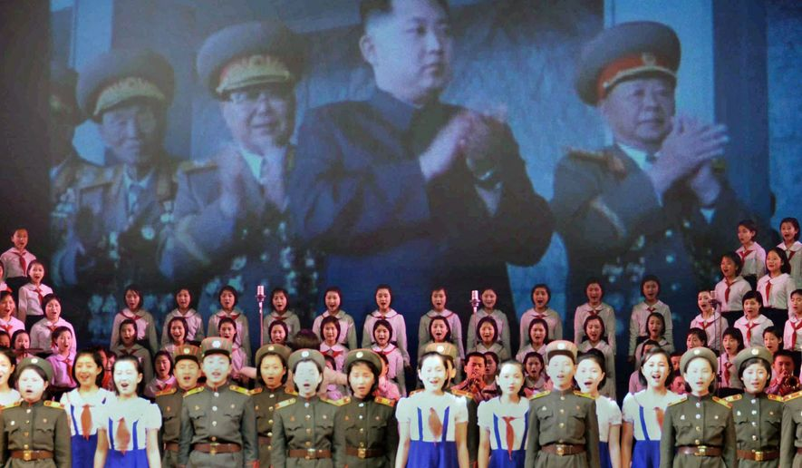 'DEAR LEADER': An image of North Korea's designated leader-to-be, Kim Jong-un (center), is shown on a screen during a performance celebrating the 69th birthday of Mr. Kim's father and current leader, Kim Jong-il. Outside information is increasingly penetrating into the secretive state. (Kyodo News via Associated Press)