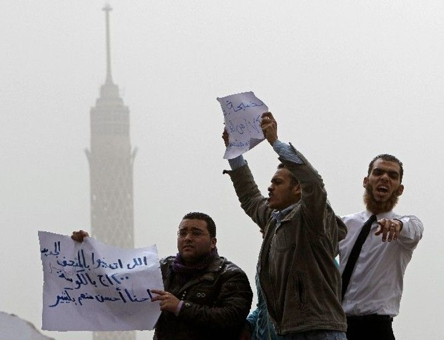 Jobless archeology graduates protest to demand jobs in the Egyptian Museum in Cairo on Wednesday. Strikes and protests erupted in Egypt after the uprising that toppled President Hosni Mubarak. (Associated Press)
