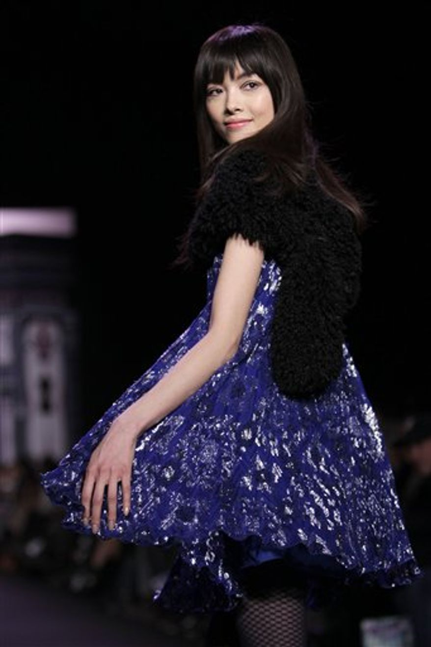 Fall 2011 fashion from Anna Sui is modeled during Fashion Week in New York, Wednesday, Feb. 16, 2011. (AP Photo/Seth Wenig)